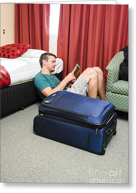 Immersed Greeting Cards - Tourist planning travel tour in hotel room Greeting Card by Ryan Jorgensen