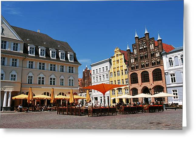 Market Square Greeting Cards - Tourists At A Sidewalk Cafe, Stralsund Greeting Card by Panoramic Images