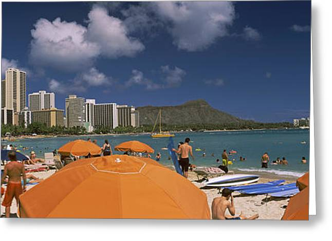 Pacific Islands Greeting Cards - Tourists On The Beach, Waikiki Beach Greeting Card by Panoramic Images