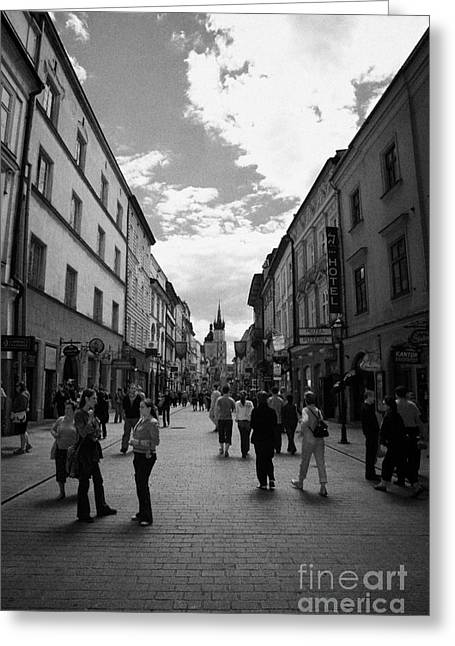 Polish City Greeting Cards - Tourists On The Ulica Florianska Street Leading Down From City Gates To Old Town City Centre Krakow Greeting Card by Joe Fox