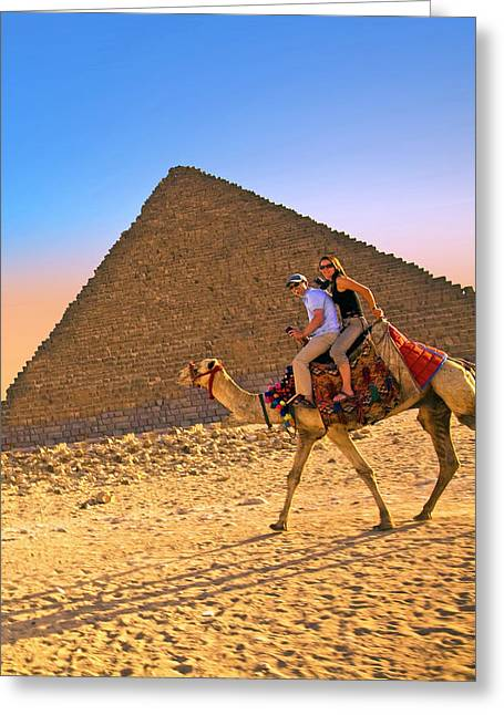 Tourists Ride A Camel In Front Greeting Card by Miva Stock