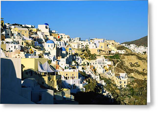 Oia Greeting Cards - Town On An Island, Oia, Santorini Greeting Card by Panoramic Images