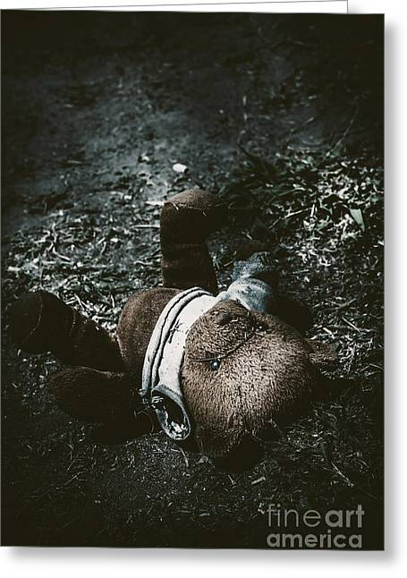 Missing Child Photographs Greeting Cards - Toy teddy bear lying abandoned in a dark forest Greeting Card by Ryan Jorgensen
