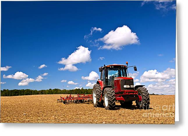 Plowing Field Greeting Cards - Tractor in plowed field Greeting Card by Elena Elisseeva