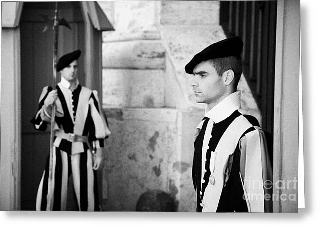 Swiss Guard Greeting Cards - Two Papal Swiss Guards stand guard in traditional uniform with pike in Vatican City Rome Lazio Italy Greeting Card by Joe Fox