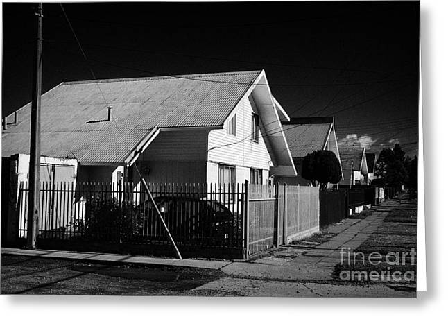 Tin Roof Greeting Cards - typical chilean construction house with metal tin roof Punta Arenas Chile Greeting Card by Joe Fox