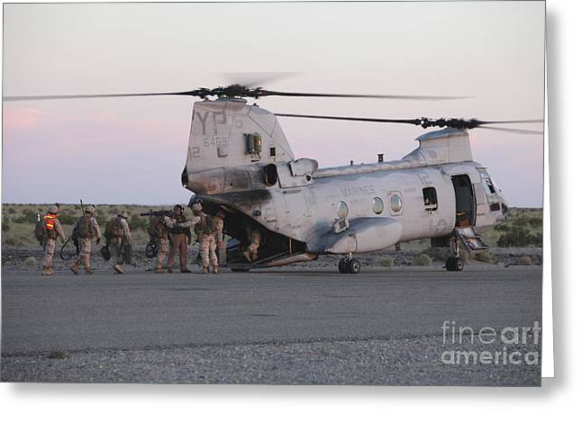 Ch-46 Greeting Cards - U.s. Marines Board A Ch-46 Sea Knight Greeting Card by Stocktrek Images