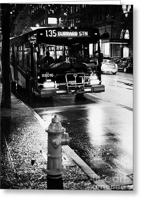 North Vancouver Greeting Cards - Vancouver city bus at stop on wet street in early evening in downtown city centre BC Canada Greeting Card by Joe Fox
