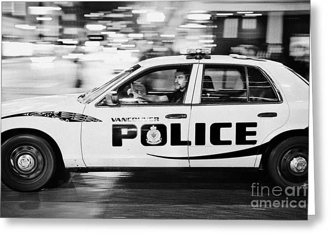 North Vancouver Greeting Cards - Vancouver police squad patrol car vehicle BC Canada deliberate motion blur Greeting Card by Joe Fox