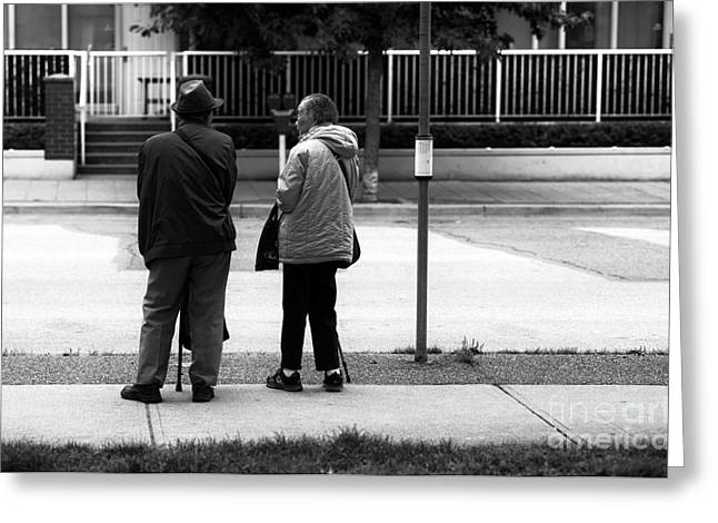 Waiting For The Bus Greeting Card by John Rizzuto