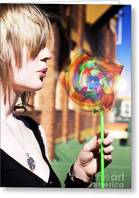 Rotate Greeting Cards - Woman Blowing Windmill Toy Greeting Card by Ryan Jorgensen