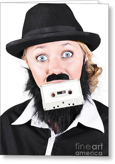 Cassettes Greeting Cards - Woman In Male Costume Holding Cassette In Mouth Greeting Card by Ryan Jorgensen