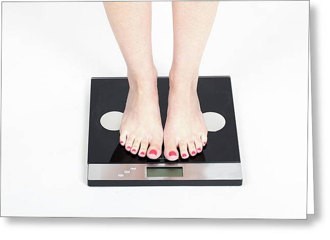 Woman's Feet On Scale Greeting Card by Photostock-israel