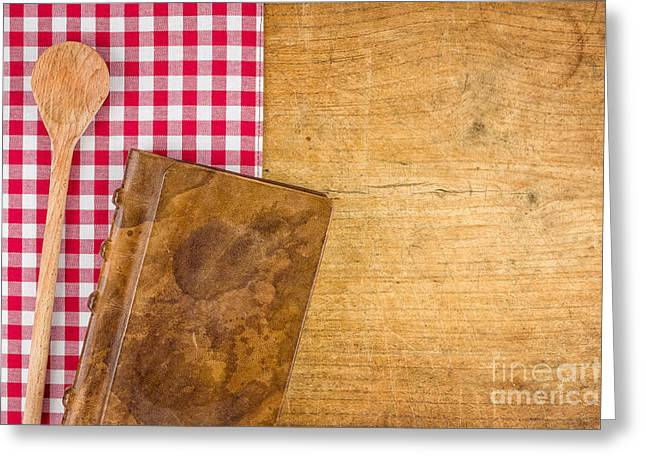 Menu Greeting Cards - Wooden spoon and book on a wooden board with a checkered tablecloth Greeting Card by Palatia Photo