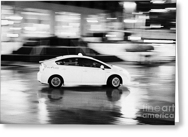 North Vancouver Greeting Cards - yellow cab taxi downtown Vancouver city at night BC Canada deliberate motion blur Greeting Card by Joe Fox