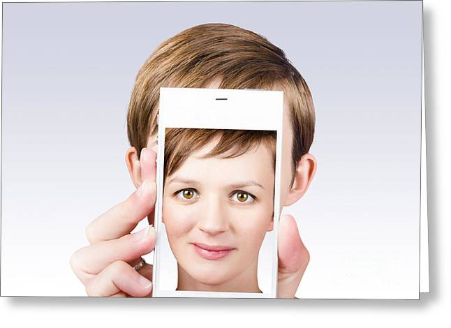 Online Marketing Greeting Cards - Young pretty woman smiling on smartphone screen Greeting Card by Ryan Jorgensen