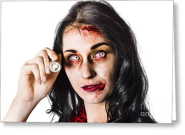 Ghastly Greeting Cards - Zombie woman holding flashlight on white Greeting Card by Ryan Jorgensen