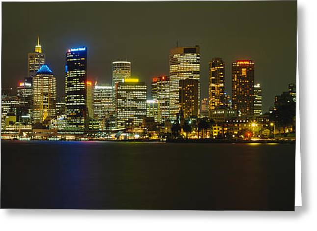 Panoramic Ocean Greeting Cards - Buildings At The Waterfront Lit Greeting Card by Panoramic Images