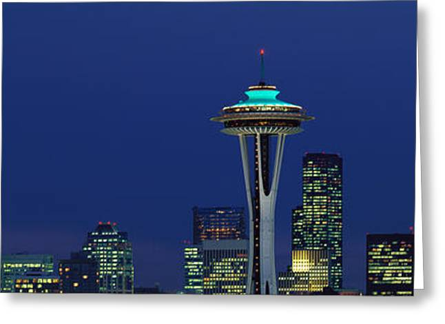 Office Space Photographs Greeting Cards - Buildings In A City Lit Up At Night Greeting Card by Panoramic Images