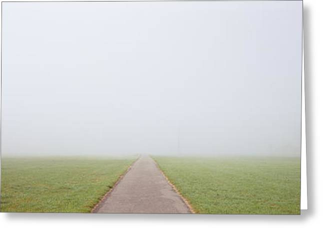 Foggy Day Greeting Cards - Road Passing Through A Landscape Greeting Card by Panoramic Images