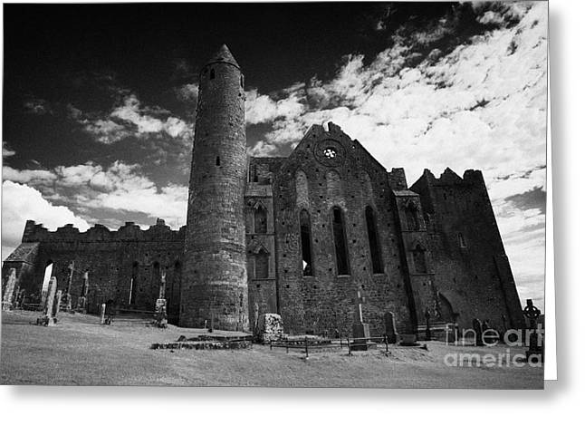 Cathedral Rock Greeting Cards - 12th Century Round Tower And 13th Century Cathedral Rock Of Cashel Tipperary Ireland Greeting Card by Joe Fox
