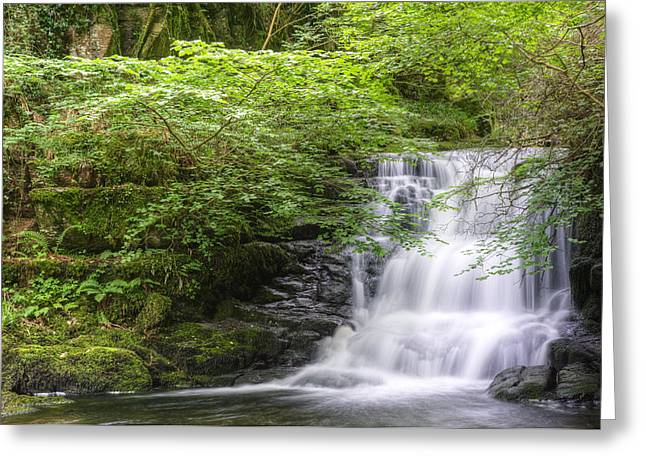 Lush Green Greeting Cards - Stunning waterfall flowing over rocks through lush green forest  Greeting Card by Matthew Gibson