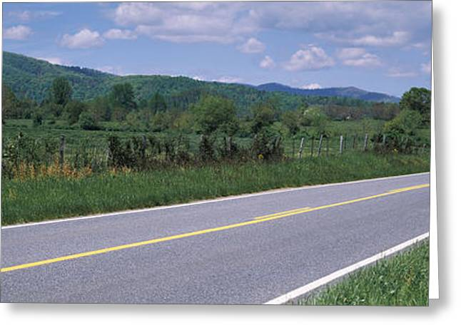 Yellow Line Greeting Cards - Road Passing Through A Landscape Greeting Card by Panoramic Images