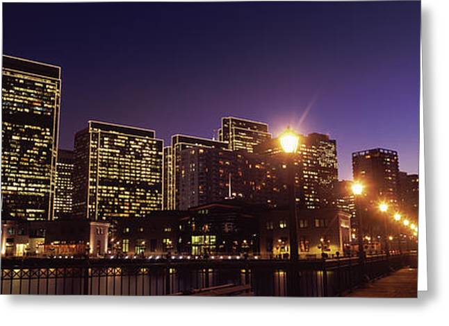 Downtown San Francisco Greeting Cards - Buildings At The Waterfront Lit Greeting Card by Panoramic Images