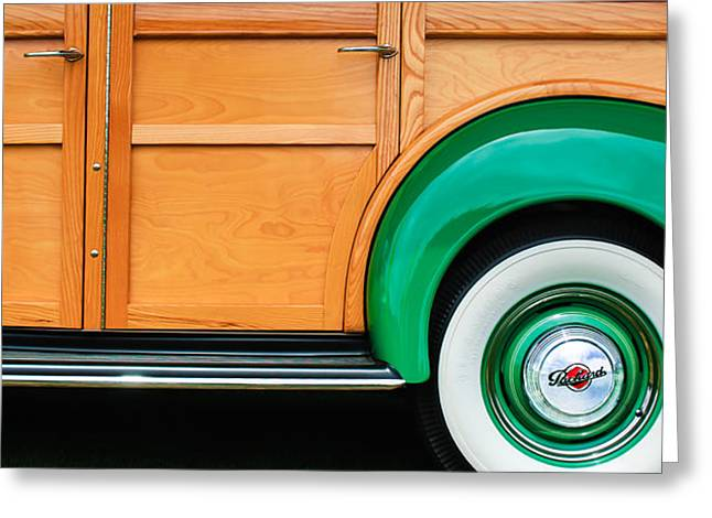 Wagon Wheels Photographs Greeting Cards - 1940 Packard 120 Woody Station Wagon Wheel Emblem Greeting Card by Jill Reger