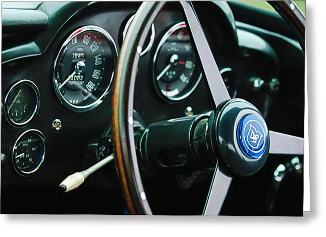 1960 Greeting Cards - 1960 Aston Martin DB4 GT Coupe Steering Wheel Emblem Greeting Card by Jill Reger