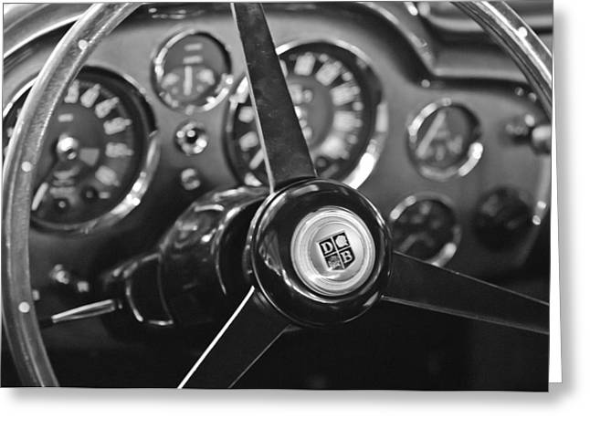 Best Images Photographs Greeting Cards - 1968 Aston Martin Steering Wheel Emblem Greeting Card by Jill Reger