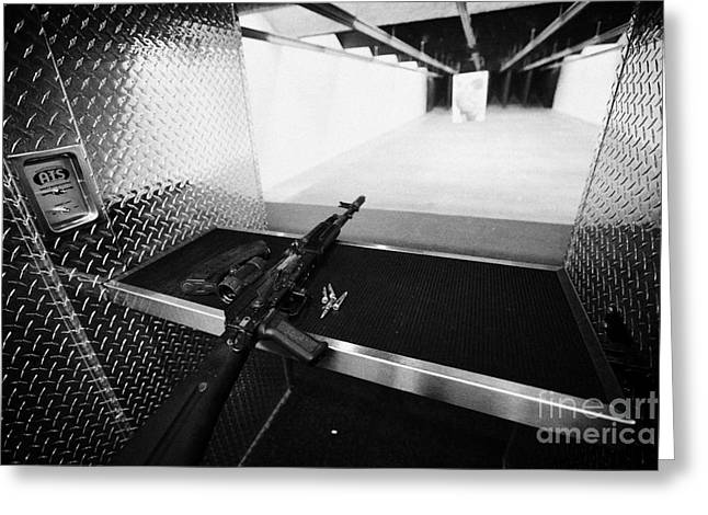 Ak47 Greeting Cards - AK47 assault rifle magazine and ammunition at a gun range in las vegas nevada usa Greeting Card by Joe Fox