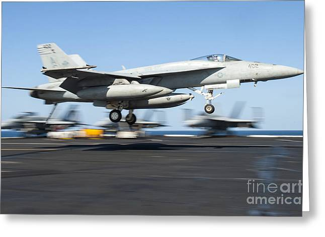 Military Airplanes Greeting Cards - An Fa-18e Super Hornet Lands Greeting Card by Stocktrek Images
