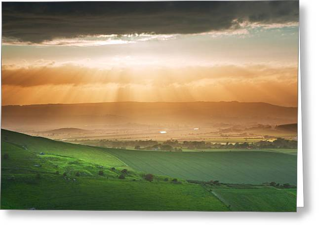 Colorful Cloud Formations Greeting Cards - Beautiful English countryside landscape over rolling hills Greeting Card by Matthew Gibson
