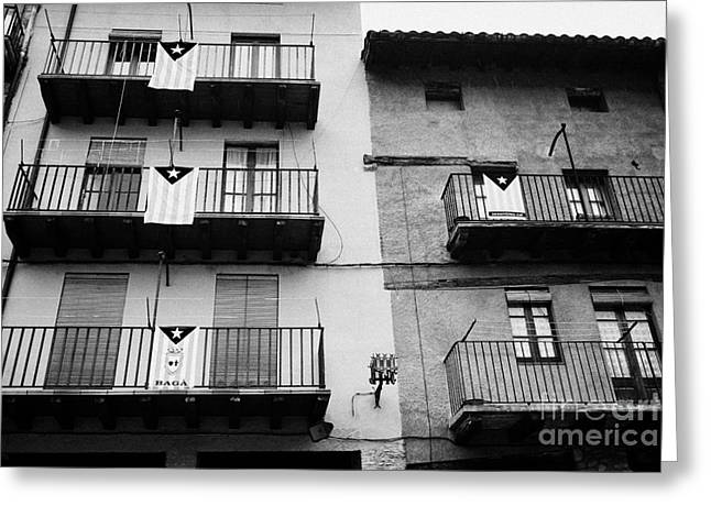 Catalunya Greeting Cards - Blue Estelada Catalonian Independence Flag Hanging From Houses In Old Town Of Baga Catalonia Spain Greeting Card by Joe Fox