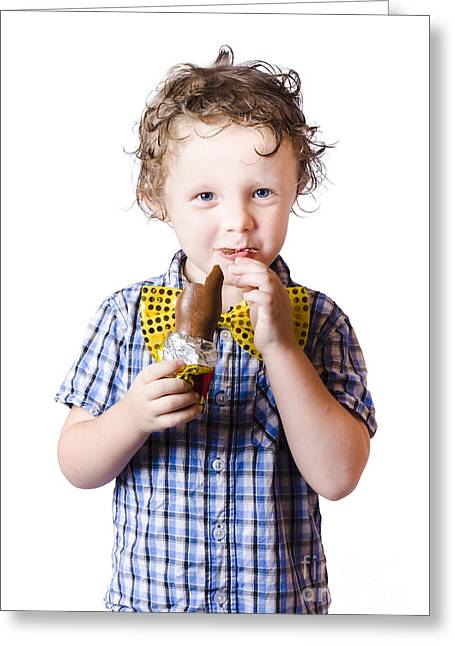 Youthful Photographs Greeting Cards - Boy eating Easter egg Greeting Card by Ryan Jorgensen