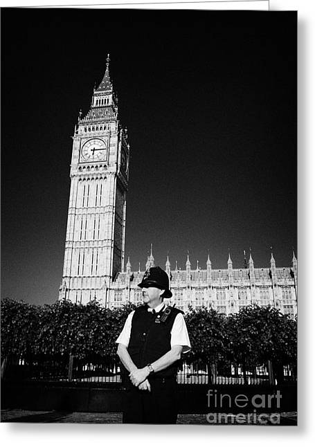 Bobby Hat Greeting Cards - british metropolitan police office guarding the houses of parliament London England UK Greeting Card by Joe Fox
