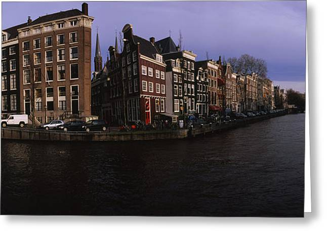 Overcast Day Greeting Cards - Buildings Along A Canal, Amsterdam Greeting Card by Panoramic Images