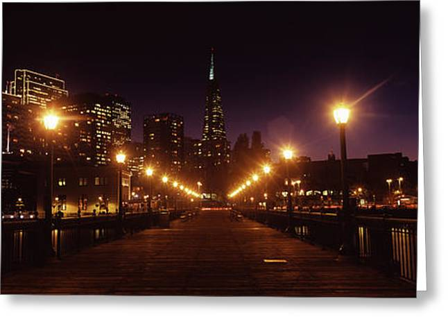 California Ocean Photography Greeting Cards - Buildings At The Waterfront Lit Greeting Card by Panoramic Images