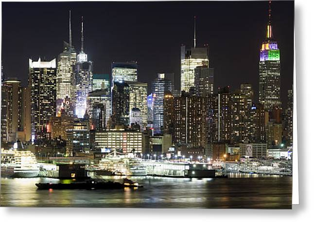 Midtown Greeting Cards - Buildings In A City Lit Up At Night Greeting Card by Panoramic Images