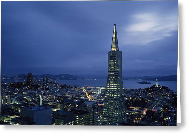 Financial District San Francisco Greeting Cards - Buildings Lit Up At Dusk, Transamerica Greeting Card by Panoramic Images