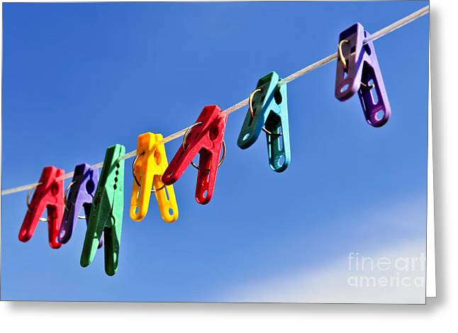 Housework Greeting Cards - Colorful clothes pins Greeting Card by Elena Elisseeva