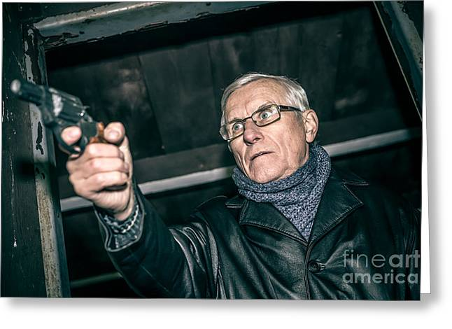 Escapees Photographs Greeting Cards - Dangerous senior with a gun Greeting Card by Jan Mika