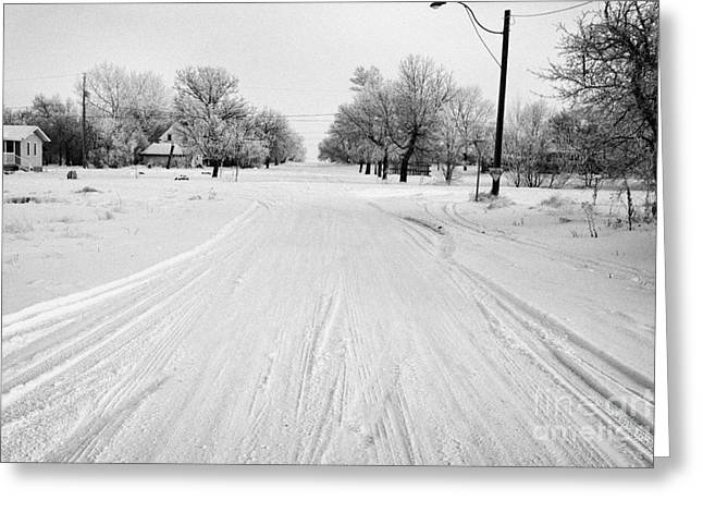 Snow Covered Village Greeting Cards - empty intersection on snow covered street in small rural farming community village Forget Saskatchew Greeting Card by Joe Fox