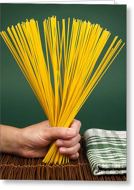 Spaghetti Noodles Greeting Cards - Female hand holding spaghetti Greeting Card by Deyan Georgiev