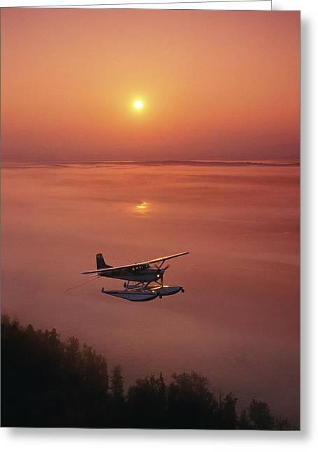 Moving Away Greeting Cards - Floatplane Flying  Sunset Matanuska Greeting Card by Jeff Schultz