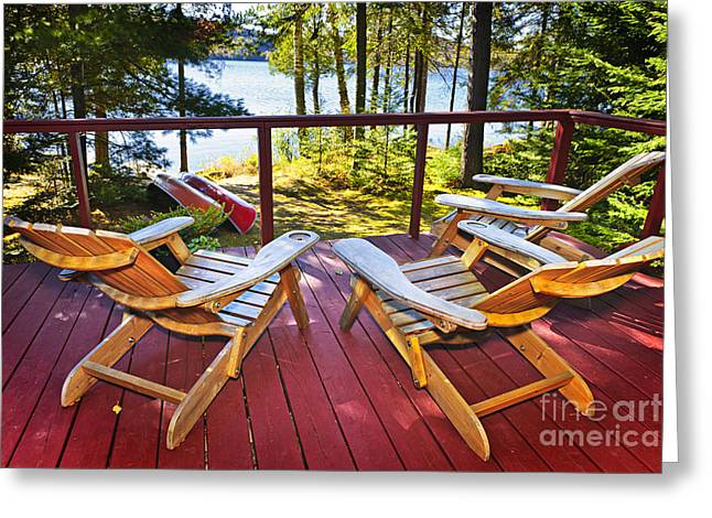 Green Canoe Greeting Cards - Forest cottage deck and chairs Greeting Card by Elena Elisseeva