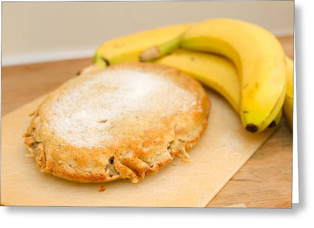 Moist Greeting Cards - Freshly baked banana cake on wooden table top Greeting Card by Fizzy Image
