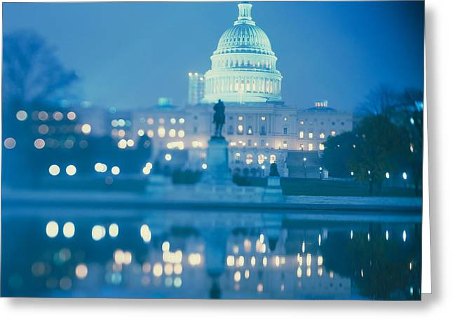 Building Reflections Greeting Cards - Government Building Lit Up At Night Greeting Card by Panoramic Images
