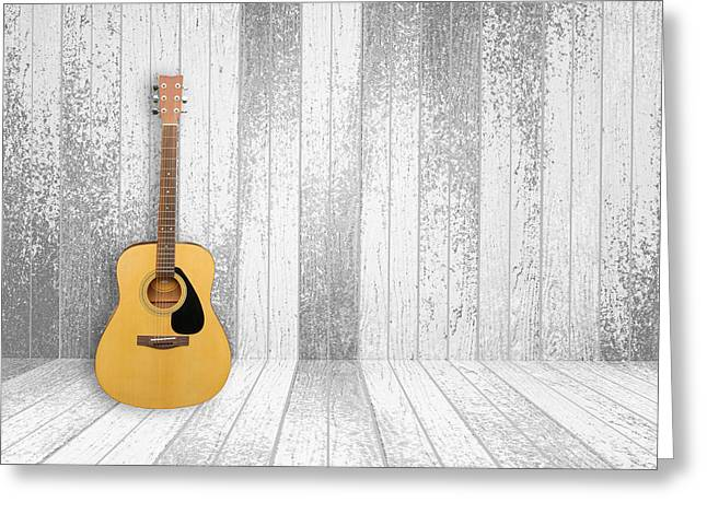 Celebrities Pyrography Greeting Cards - Guitar in old room background Greeting Card by Thanapol Kuptanisakorn